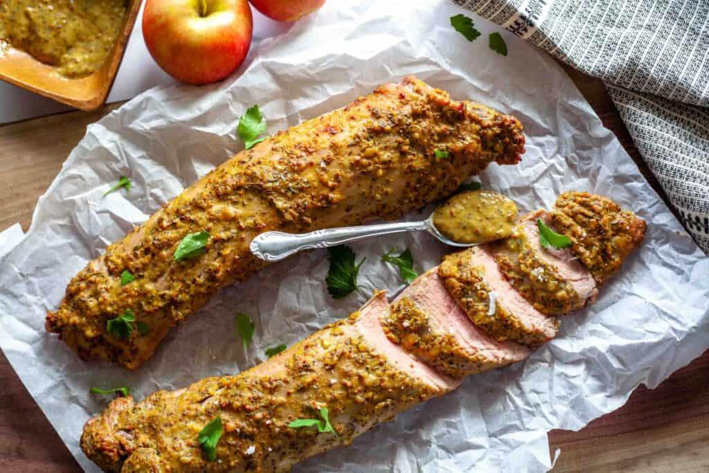 Sliced maple mustard pork tenderloin laid out