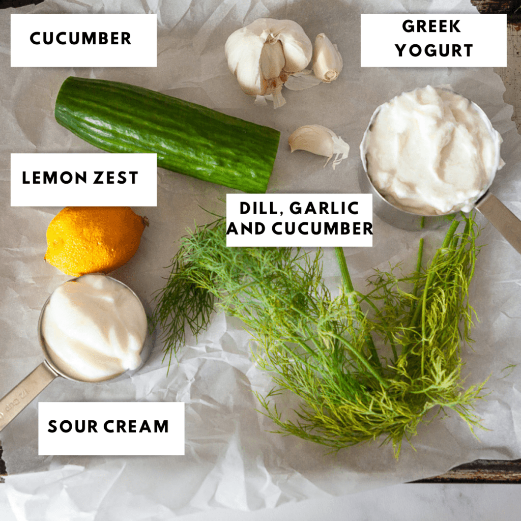 ingredients for tzatziki laid out on a sheet pan and labelled