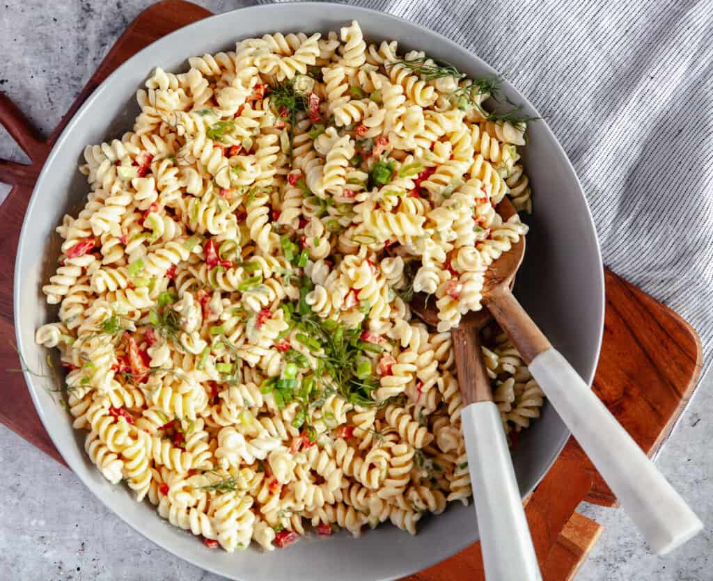 Southern macaroni salad in a bowl, with serving spoons