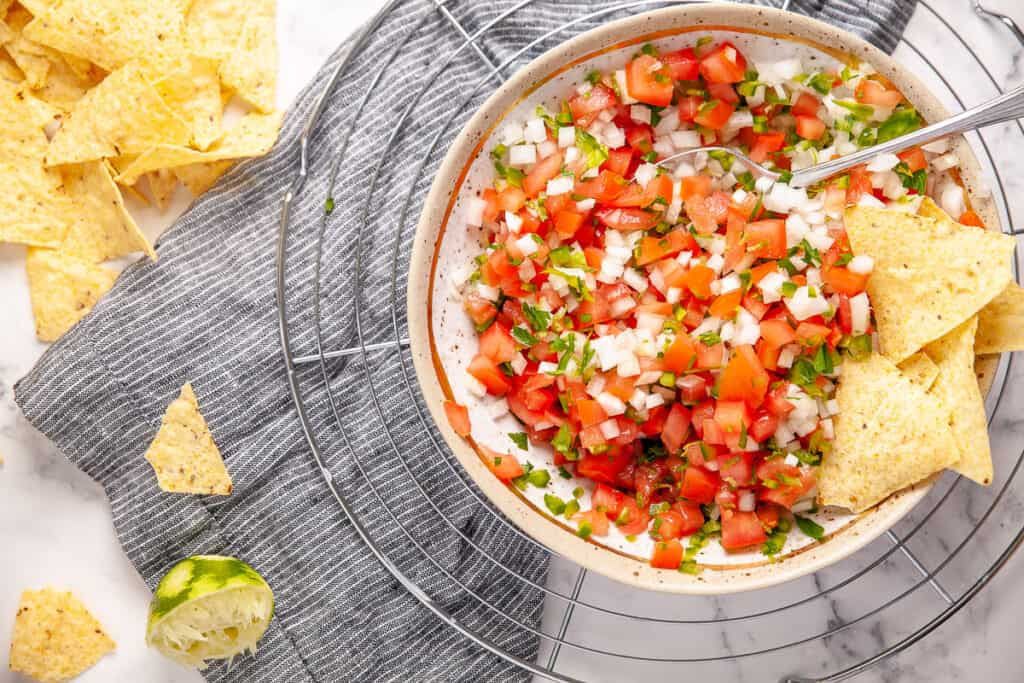 Zesty tomato salsa in a bowl with tortilla chips