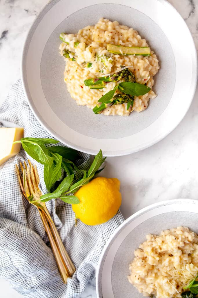 Spring lemon risotto plated in a bowl, topped with mint