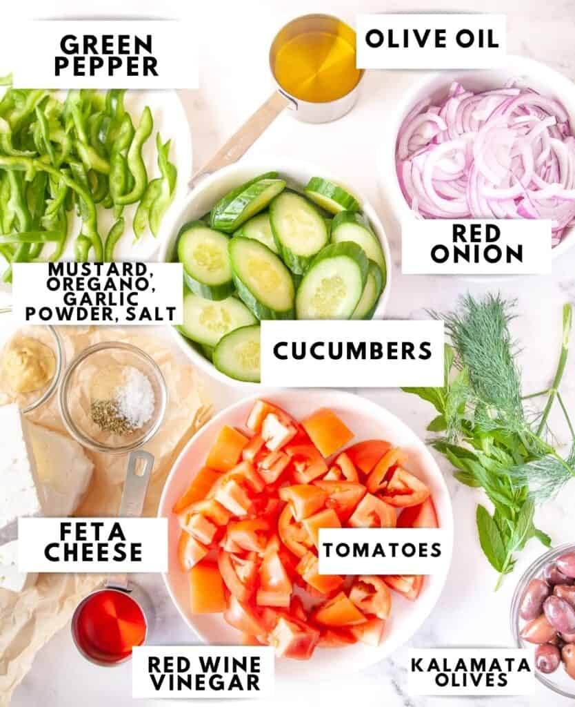 Ingredients for Greek salad laid out and labelled
