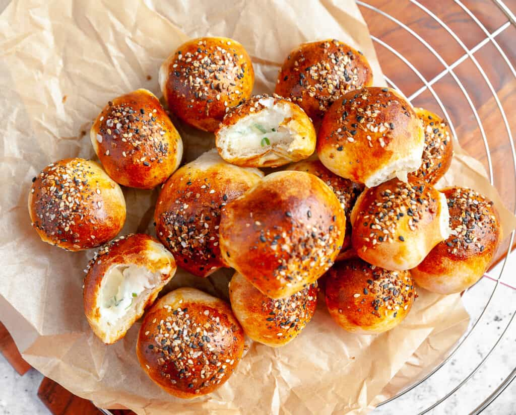 Cooked bagel bites presented on parchment paper