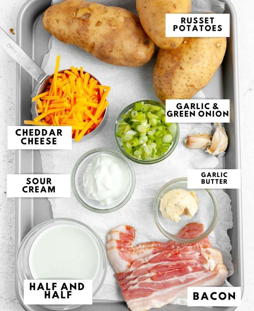 Ingredients to prepare mashed potatoes labelled on a baking sheet