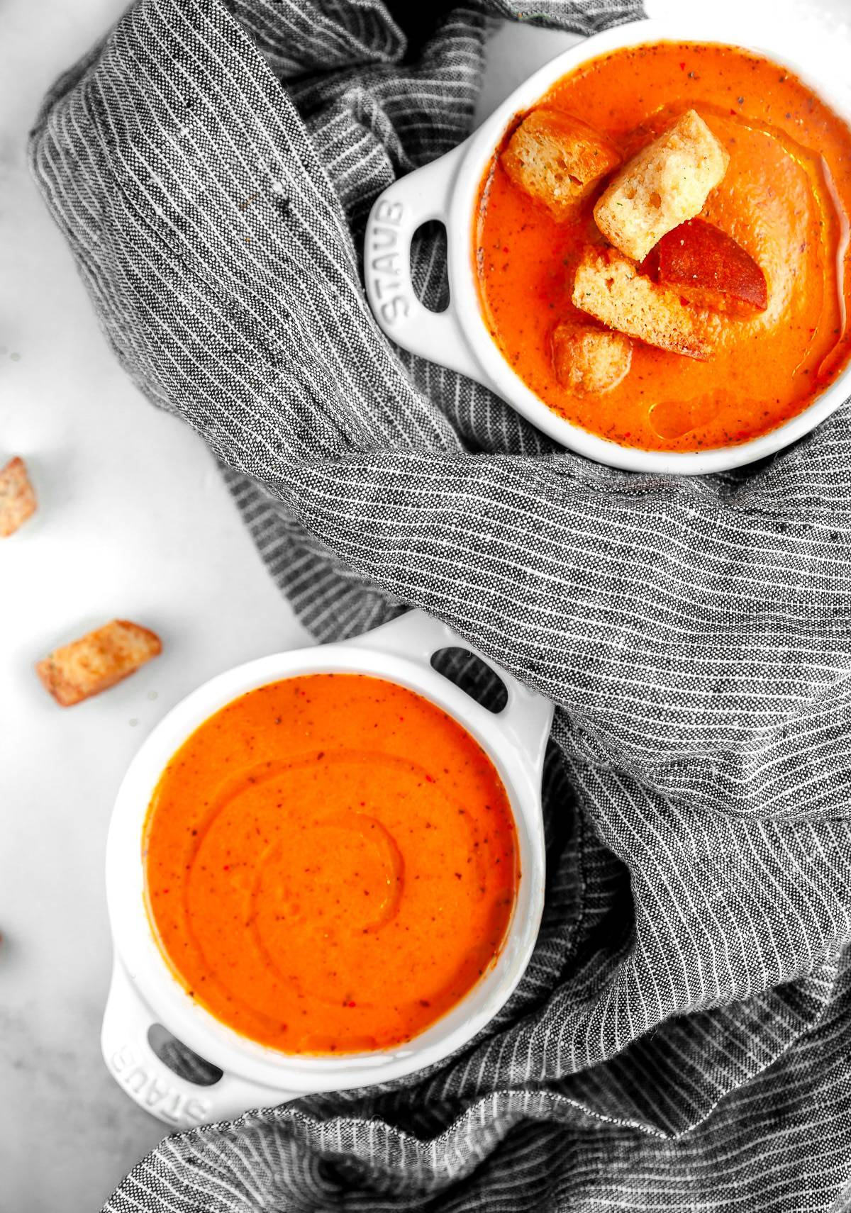 roasted red pepper soup in small bowls with croutons on top